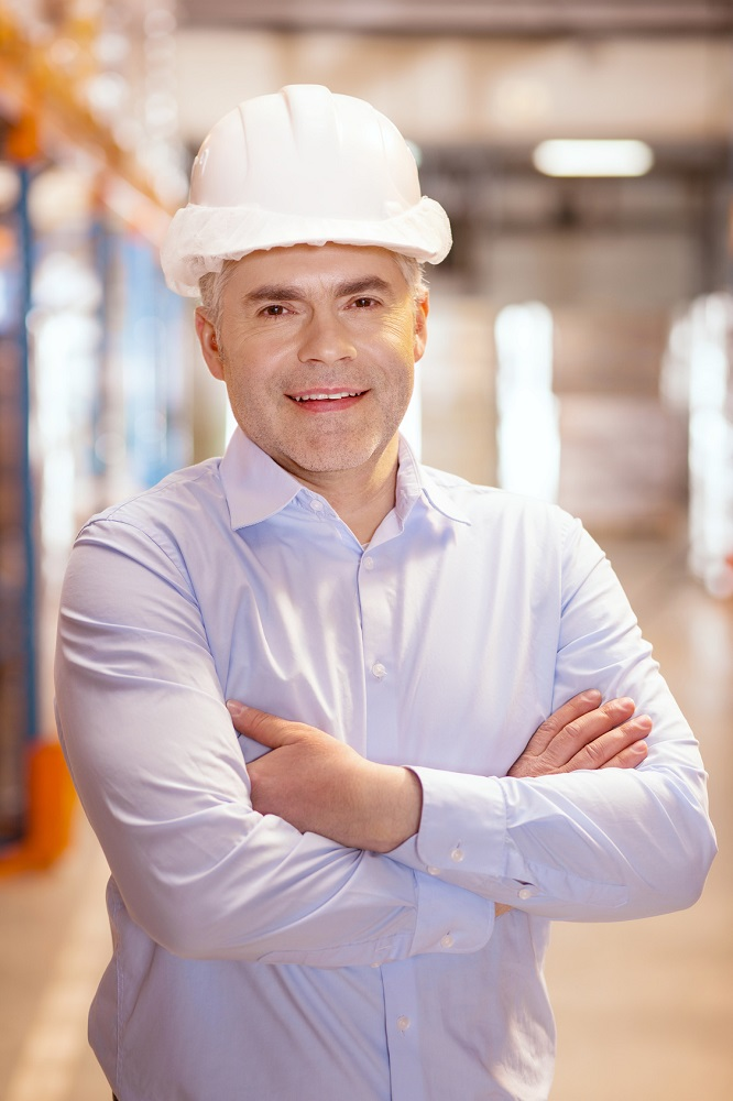 Positive warehouse worker smiling